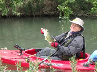 Larry lands a nice LMB on a topwater