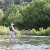 Robert fishing the fast water, and hooked up.