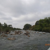 Fast water with plenty of rocks.